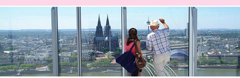 View from the K�lnTrianglePanorama: Two tourists view Cologne Cathedral